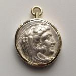 Alexander the Great Swivel Pendant: Silver tetradrachm 336-323 BC set in 18 kt. gold bezel and swivel; (obverse view) Herakles wearing skin headdress of the Nemean lion killed during his first labor.