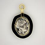 "Athena and Owl Swivel Pendant: (Obverse view) Silver tetradrachm 300-390 BC set in handcrafted matte black enamel on silver frame; handcrafted 18 kt. bezel and swivel; approximate size 2"" long x 1.5"" wide."