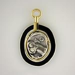 "Athena and Owl Swivel Pendant: (Reverse view) Silver tetradrachm 300-390 BC set in handcrafted matte black enamel on silver frame; handcrafted 18 kt. bezel and swivel; approximate size 2"" long x 1.5"" wide."