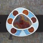 "Belt Buckle II: Champleve enamel on silver with silver and gold leaf; designed, laid out, and pierced by hand; Kentucky agate, set in handmade and riveted silver bezels; 2.75"" x 2.375"" x 3 mm. (Belt not included)"