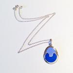 Egg Pendant II: (Shown with chain) Enamel on silver; Pendant size, 32 mm high x 23 mm wide x 2 mm thick.