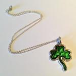 Shamrock Pendant: Green transparent enamel on silver with gold leaf; Pendant size, 40mm high x 28mm wide x 3mm thick.
